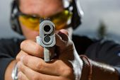 stock photo of shooting-range  - Man shooting on an outdoor shooting range - JPG