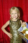 UNIVERSAL CITY - DEC. 4: Alyvia Alyn Lind arrives at publicist Mike Arnoldi's birthday celebration &