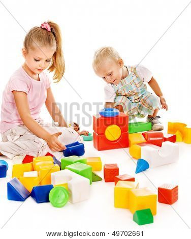 Happy children playing building blocks. Isolated.