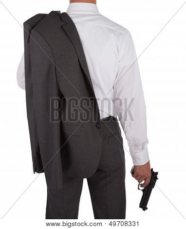 Man In A Suit Holding A Gun