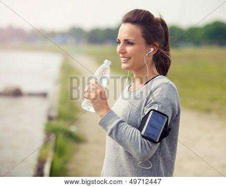 Female Runner Drinking Bottled Water