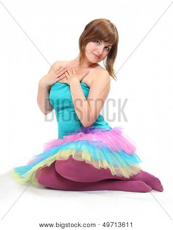 Pretty dancer dressed in retro costume sitting on a white background.