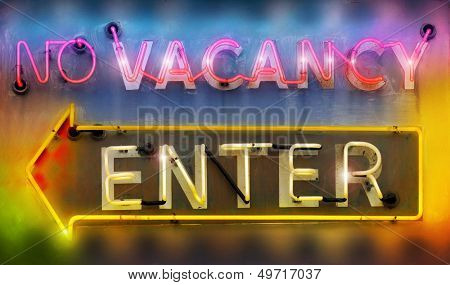 Old retro neon signs reading 'no vacancy' and 'enter' in vibrant cool colors