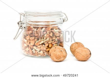 Bank With Shelled Walnuts And Three Whole Walnuts.