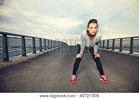 Focused Female Runner Resting