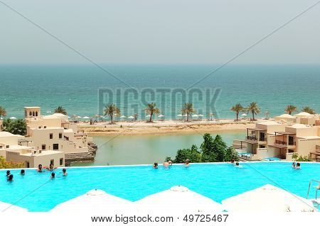 RAS AL KHAIMAH UAE - JUNE 9: The tourists enjoying their vacation at luxury hotel on June 9 2012