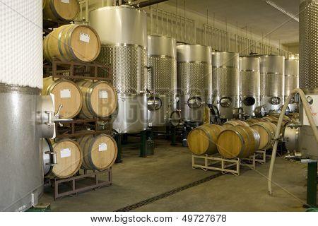 Fermentation tanks and barrels of wine in cellar