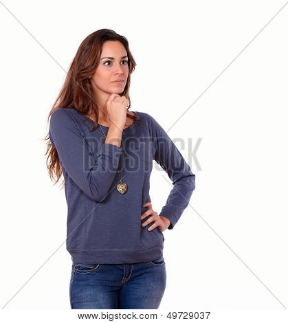 Interested Latin Young Woman Reflecting Alone