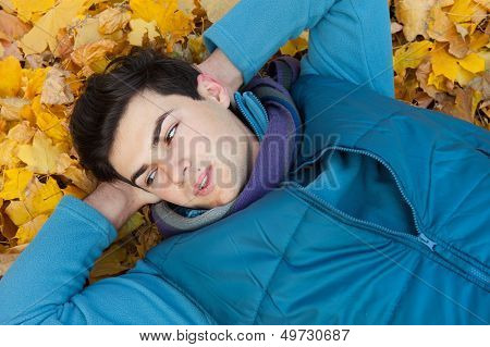 Young handsome man portrait. Autumn outdoor.