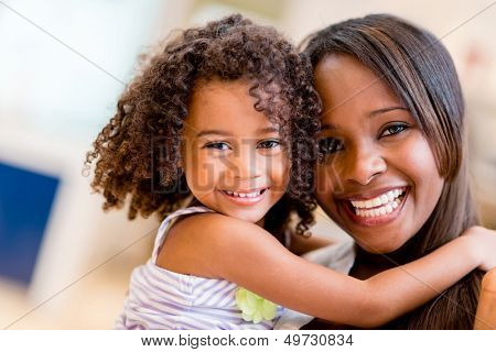 Happy portrait of a mother and daughter smiling