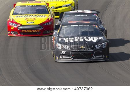 BROOKLYN, MI - AUG 18, 2013:  Kurt Busch (78) brings his race car through the turns during the Pure Michigan 400 race at the Michigan International Speedway in Brooklyn,  MI on Aug 18, 2013.