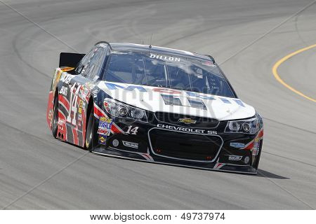 BROOKLYN, MI - AUG 16, 2013:  Austin Dillon (14) brings his race car through the turns during the Pure Michigan 400 race at the Michigan International Speedway in Brooklyn, MI on Aug 16, 2013.