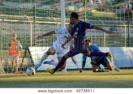 KAPOSVAR, HUNGARY - AUGUST 3: Unidentified players in action at a Hungarian National Championship soccer game - Kaposvar (white) vs Kecskemet (purple) on August 3, 2013 in Kaposvar, Hungary.