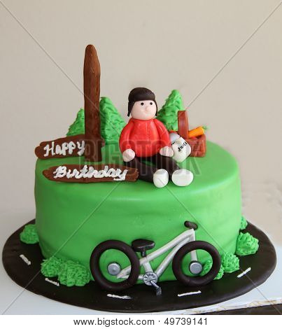 Bicyclist green birthday cake