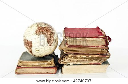 Old books and globe earth on white background