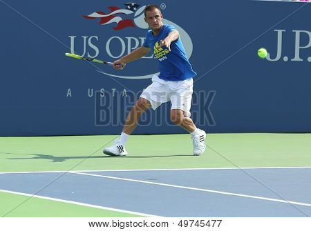 Professional tennis player Mikhail Youzhny practices for US Open 2013 at Louis Armstrong Stadium