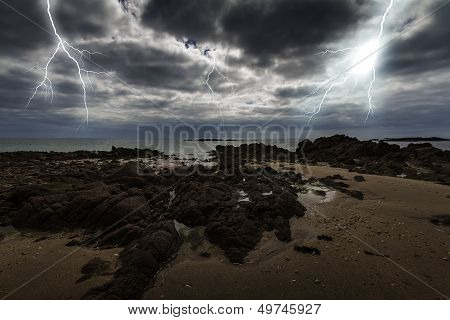 Flash lightning over the ocean on Jersey island
