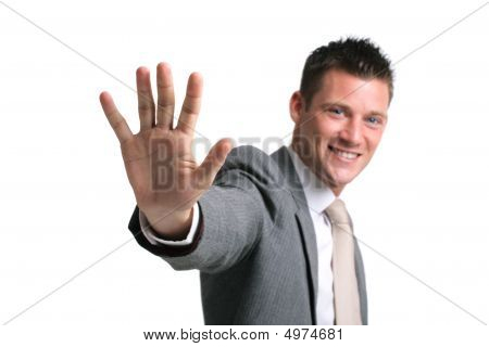 Young Businessman Showing An Opened Palm