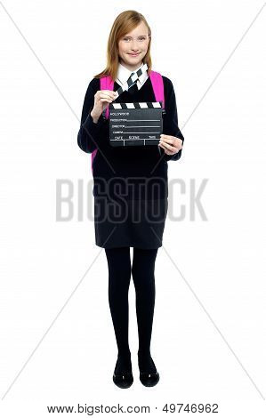 Cute School Girl With A Clapperboard