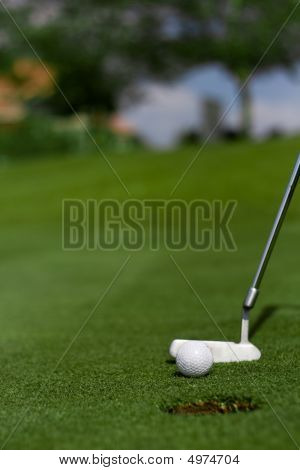 Putting Golf Ball In Hole