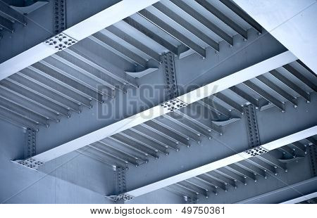 Elements Of Modern Steel Automotive Bridge Construction. Beams And Bolts Steel Structure On The Bott
