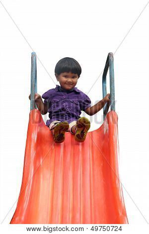 Beautiful Cheerful(happy) Indian Girl(kid) On Slider In A Summer Day
