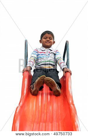 Isolated Photo Of Handsome Indian Boy(kid) On Slider At A Park
