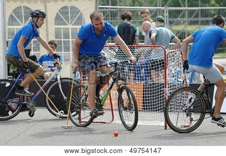 Three Bicycle Polo Players