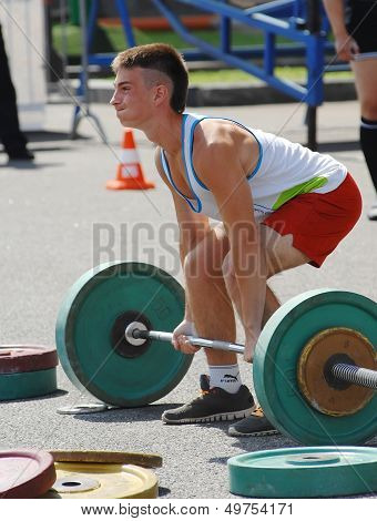 Young Athlete Raises The Barbell
