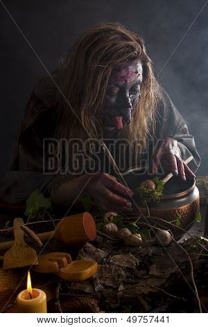 Herbalist Brewing Up A Soup