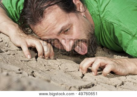 Thirsty Man On Parched Soil