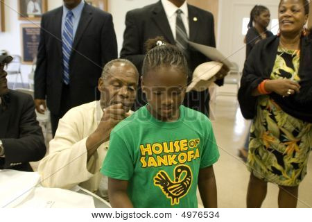 Actor Danny Glover Signing A Shirt For A Fan 2
