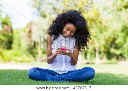 Teenage African American Girl Using A Phone