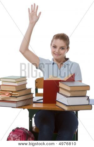 Caucasian Schoolgirl With Raised Hand In Class