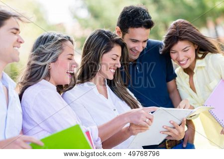 Happy group of university students smiling outdoors
