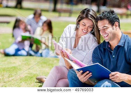Happy couple studying at the university campus