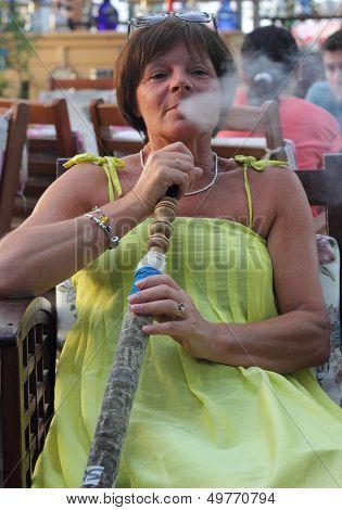 smoking a hookah water pipe