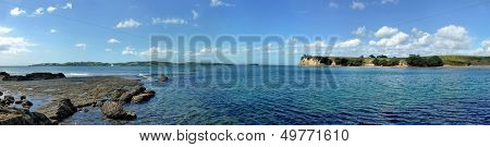 Panoramic View From A Shore Onto The Sea With Islands