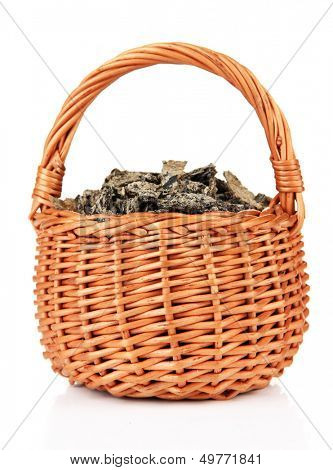 Oil cake in wicker basket, isolated on white