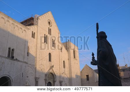 basilica and silhouette statue of St. Nicholas thaumaturge in old Town of Bari