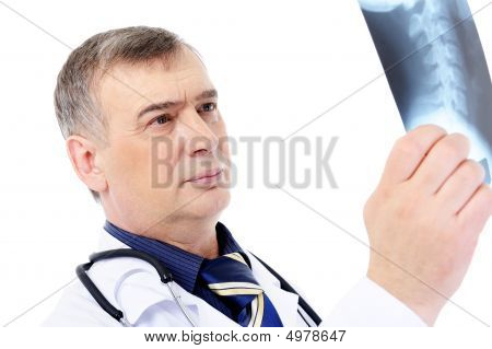 Mature Male Doctor Looking On The X-ray