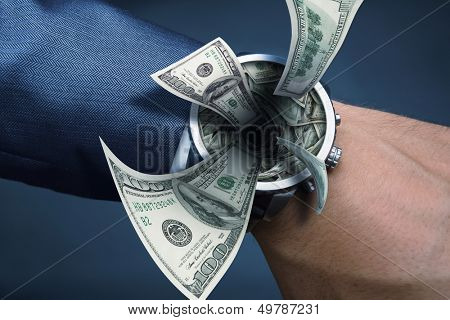 Watch on businessman hand sucking money