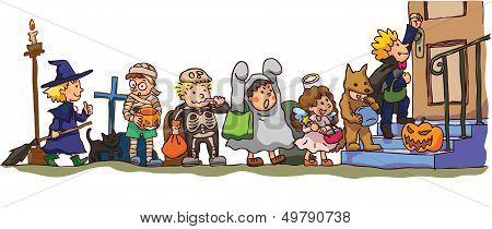 Kids Celerbrating Halloween. It's Trick Or Treat!