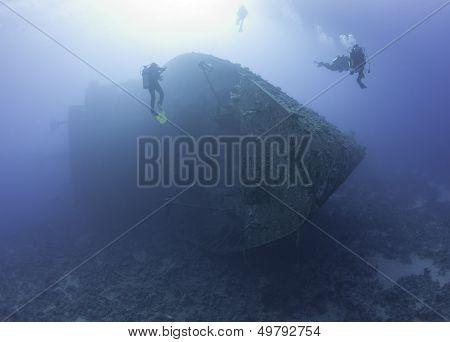 Scuba Divers Exploring A Shipwreck