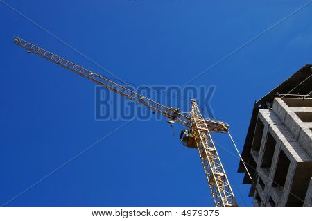 The Elevating Crane Against The Dark Blue Sky