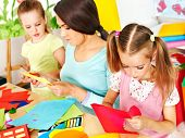pic of preschool  - Children  cutting out scissors paper in preschool - JPG