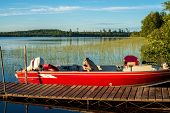 picture of mile  - a fishing boat docked on four mile lake in northern minnesota - JPG