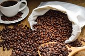 foto of spit-roast  - coffee beans and coffee cup on burlap - JPG