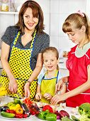 foto of pinafore  - Mother and daughter cooking at kitchen - JPG