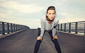 stock photo of jogger  - Female runner with focus and determination to run - JPG